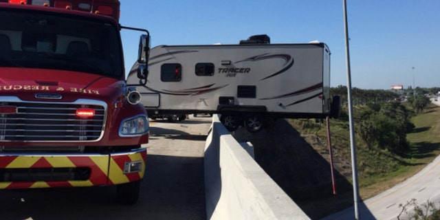 A 3-vehicle crash led to a camper hanging off a Florida overpass.