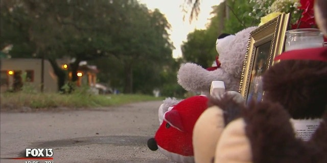 A memorial in the Seminole Heights neighborhood in Tampa, where 3 people were killed in 10 days in October.