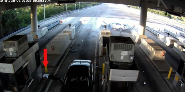 A passenger ejected from a vehicle landed near the toll booth near where a car was paying a toll.