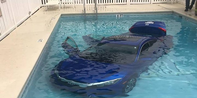 The vehicle was nearly submerged in the pool, but no injuries were reported.