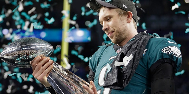 Philadelphia Eagles' Nick Foles holds up the Vince Lombardi Trophy after the NFL Super Bowl 52 football game against the New England Patriots, Sunday, Feb. 4, 2018, in Minneapolis.