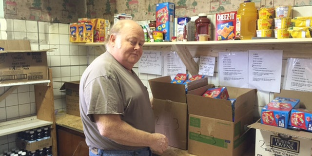 Ronnie Thornsbury, a volunteer at the food pantry, helps pack free meals for more than 1,000 people a month.