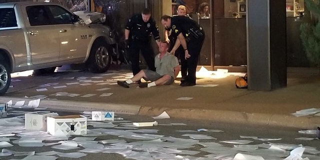 A man was arrested after crashing his truck into the studios for FOX 4 in Dallas early Wednesday.