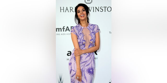 In this May 19, 2016 file photo, actress Mallika Sherawat poses for photographers upon arrival at the amfAR Cinema Against AIDS benefit at the Hotel du Cap-Eden-Roc, during the 69th Cannes international film festival, in Cap d'Antibes, southern France.