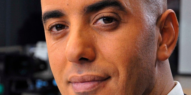 In this photo dated Nov. 22, 2010, notorious French criminal Redoine Faid poses prior to an interview with French all-news TV channel, LCI, as he was promoting his book, in Boulogne-Billancourt, outside Paris, France.