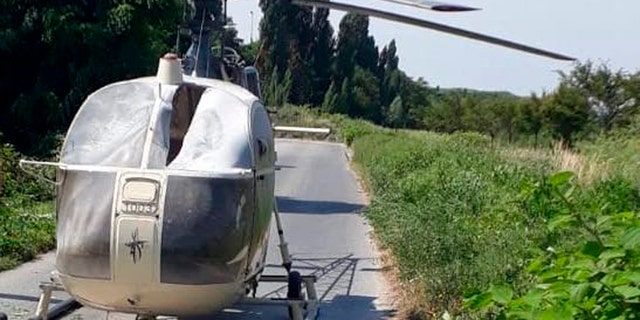 This photo taken on Sunday, July 1, 2018 and provided on Monday, July 2, 2018 by the AP on the condition that its source not be revealed shows an helicopter abandoned by notorious French criminal Redoine Faid after his escape from a prison, in Gonesse, north of Paris, France.