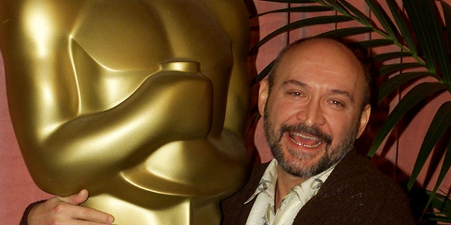 """Director Frank Darabont puts his arms around a large Oscar statue as he arrives for the Academy of Motion Picture Arts & Sciences Oscar nominee luncheon, March 13 in Beverly Hills. Darabont is nominated as best director for his film """"The Green Mile."""" The Academy Awards will be presented March 26 in Los Angeles.FSP/HB - RTR27IY"""