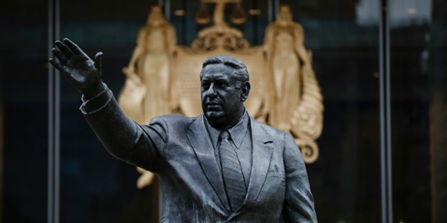 Shown is a statue of the late Philadelphia Mayor Frank Rizzo, who also served as the city's police commissioner outside the Municipal Services Building in Philadelphia, Friday, Aug. 18, 2017. (AP Photo/Matt Rourke)