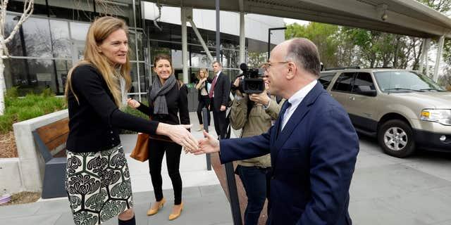 Feb. 20, 2015: Google Senior Vice President of Communication Rachel Whetstone, left, greets French Interior Minister Bernard Cazeneuve upon his arrival at Google headquarters.