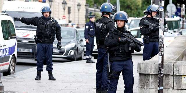 French police stand guard outside Notre Dame Cathedral after a shooting in Paris in June of 2017.
