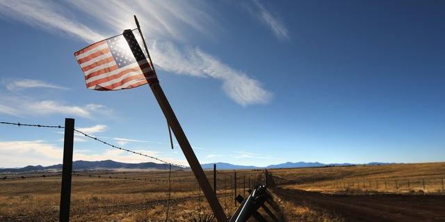 An American flag flies at the U.S.-Mexico border on February 26, 2013 near Sonoita, Arizona.