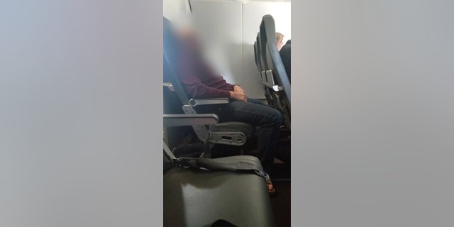 After flight attendants moved him to an empty row, the disorderly passenger was witnessed peeing on the seat directly in front of him.