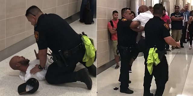 An officer wrestled an irate passenger to the ground after he started yelling about his child.