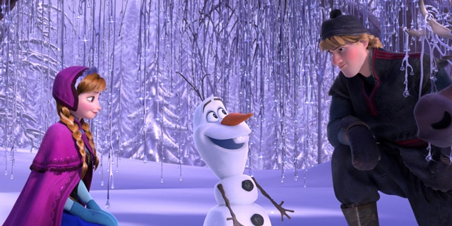 """This image released by Disney shows , from left, Anna, voiced by Kristen Bell, Olaf, voiced by Josh Gad, and Kristoff, voiced by Jonathan Groff in a scene from the animated feature """"Frozen."""""""