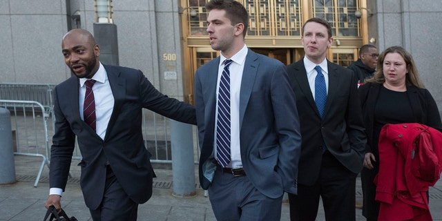 Billy McFarland, center, accompanied by his attorney Randall Jackson, left, leaves federal court after pleading guilty to wire fraud charges.