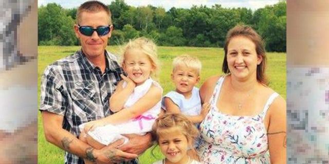 Erik Fryman, Cari Mews and their three children.