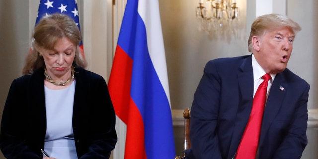 July 16: Interpreter Marina Gross takes notes while President Trump talks to Russian President Vladimir Putin.