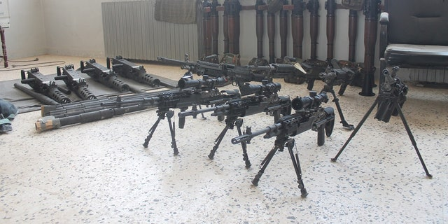Abu Zayd's weapons arsenal, in which he claims many of the arms were issued through U.S training programs.