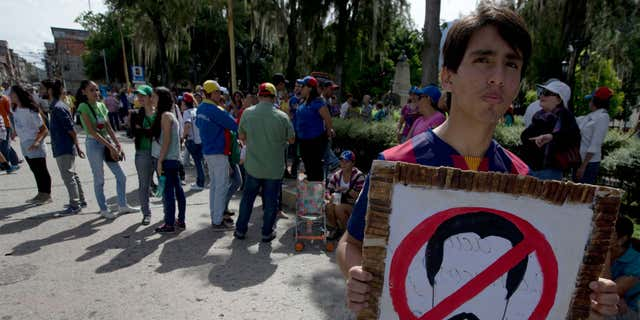 A protest against President Nicolas Maduro, in Merida, Venezuela, Wednesday, Sept. 7, 2016.