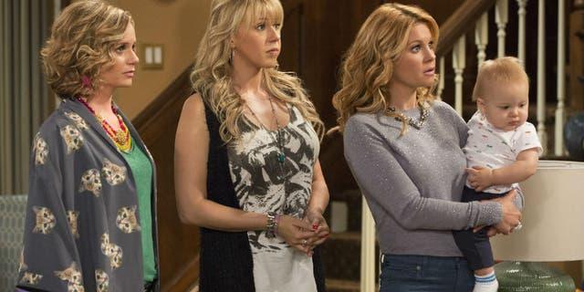 "Jodie Sweetin, center, as Stephanie Tanner on ""Fuller House."""