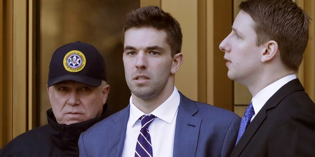 Billy McFarland, the promoter of the failed Fyre Festival in the Bahamas, leaves federal court after pleading guilty to wire fraud charges, Tuesday, March 6, 2018, in New York. (AP Photo/Mark Lennihan)