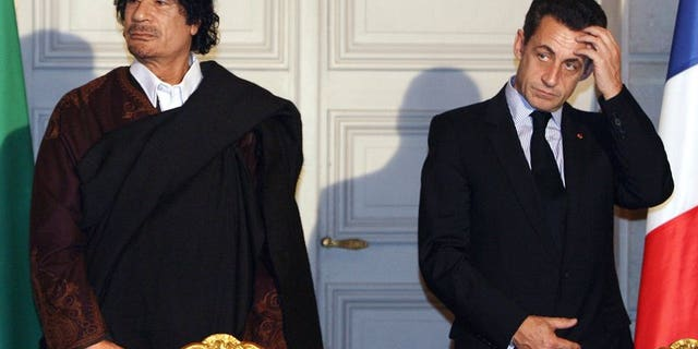 Libyan leader Col. Moammar Gadhafi, left, and French President Nicolas Sarkozy, pose during a signing ceremony at the Elysee Palace in Paris, Dec. 10, 2007.