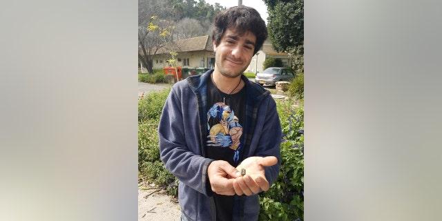 Gardener Dekel Ben-Shitrit with the ring he found. (Photo: Nir Distelfeld, Israel Antiquities Authority)