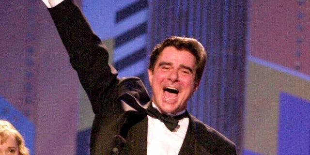 "In this June 3, 2001 file photo, actor Gary Beach accepts the award for best performance by a featured actor in a musical for his role in ""The Producers,"" during the 55th annual Tony Awards in New York. Beach died Tuesday, July 17, 2018 in Palm Springs, Calif., at the age of 70."