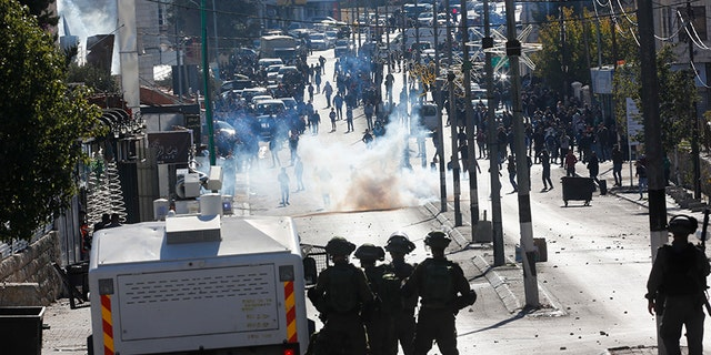 Palestinians clash with Israeli troops during a protest against the U.S. decision to recognize Jerusalem as Israel's capital.
