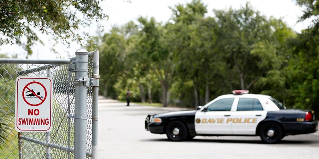 Police block the entrance to Silver Lakes Rotary Nature Park on Friday.
