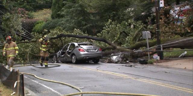 Sam Lenaeus' Mercedes became stuck near live power lines.