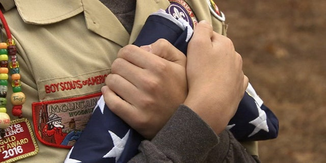 Retired naval aviator Frank Coleman was honored to have assistance from the scouts retiring his flags.