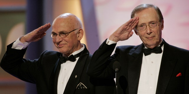 "Actors Gavin MacLeod (L) and Bernie Kopell, stars of the television series ""Love Boat"" salute producer Aaron Spelling during a tribute to his long career at the 3rd annual TV Land Awards in Santa Monica, California March 13, 2005. The awards show honored classic television shows and performers. The 3rd annual TV Land Awards will be telecast in the United States on the TV Land cable channel March 16. REUTERS/Fred Prouser  FSP - RTR507V"