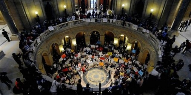 May 21: Demonstrators shout and wave signs in the State Capitol rotunda during a Peoples Rally for a Fair Minnesota as the state Legislature debated gay marriage near the end of its session.