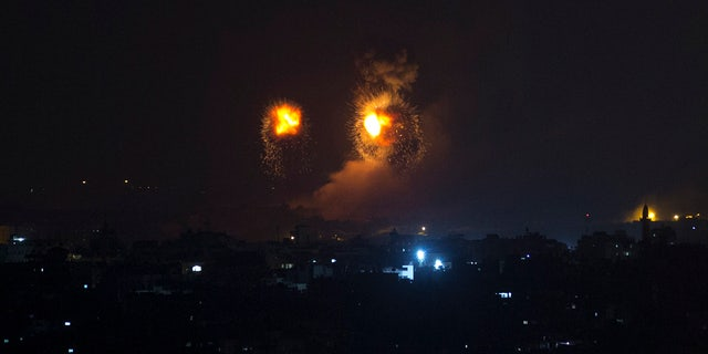 Fire balls caused by Israeli airstrikes on Gaza City, early Thursday, Aug. 9, 2018.