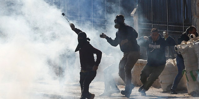 Palestinians clash with Israeli troops during a protest against President Trump's decision to recognize Jerusalem as the capital of Israel.