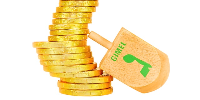 Dreidel is a traditional game for the Jewish holiday of Chanukah. Players spin, and win or lose depending on which hebrew letter appears on top. The Hebrew letter gimel wins the group of shiny wrapped chocolate coins.