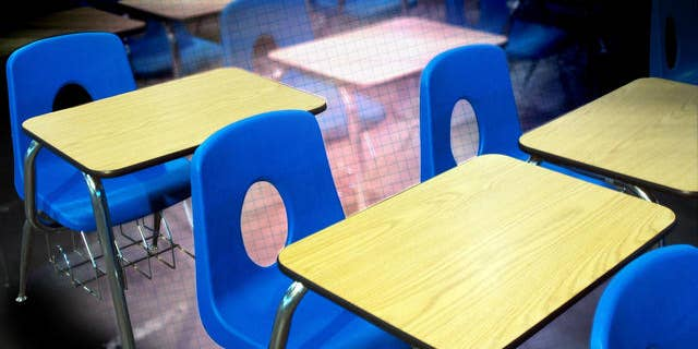 Classroom desks used at Decker College await auction Friday, Feb. 10, 2006 at the site of the former school in Louisville, Ky. Decker, a for-profit trade school run by former Massachusetts Gov. William Weld, is now closed, mired in bankruptcy proceedings and under FBI investigation in a case that has cast a long shadow over Weld's bid to become the next governor of New York. (AP Photo/Brian Bohannon)