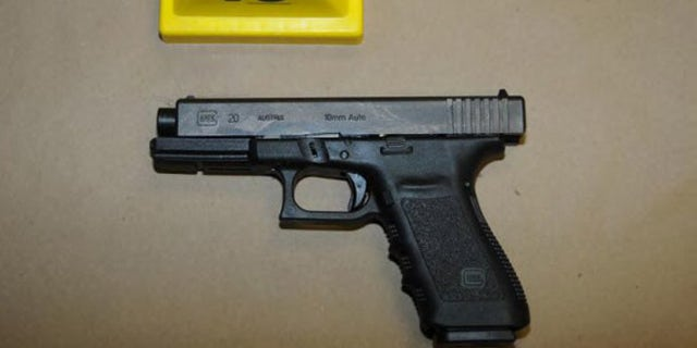NEWTOWN, CT - UNSPECIFED DATE:  In this handout crime scene evidence photo provided by the Connecticut State Police, shows a Glock 20, 10mm found near the shooter in Room 10 at Sandy Hook Elementary School following the December 14, 2012 shooting rampage, taken on an unspecified date in Newtown, Connecticut . A report was released November 25, 2013 by Connecticut State Attorney Stephen Sedensky III summarizing the Newtown school shooting that left 20 children and six women dead inside Sandy Hook Elementary School. According to the report, a motive behind the shooting by gunman Adam Lanza is still unknown.  (Photo by Connecticut State Police via Getty Images)