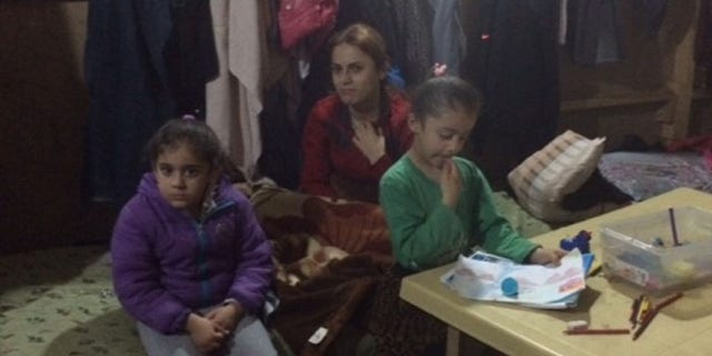 Displaced Christian family living in an abandoned building in the Kurdish region of Iraq