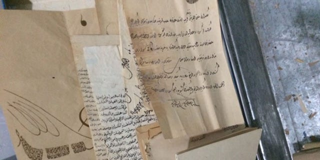 Christians now store priceless, ancient biblical scripts like these in the abandoned buildings where they live.