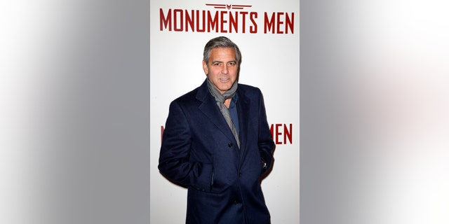 """february 12, 2014. Actor George Clooney arrives arrives for the French premiere of the film """"The Monuments Men"""" in Paris."""