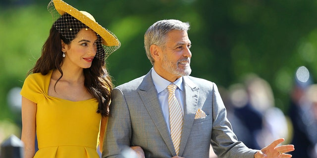 George Clooney, right, and wife Amal arrive at the royal wedding.