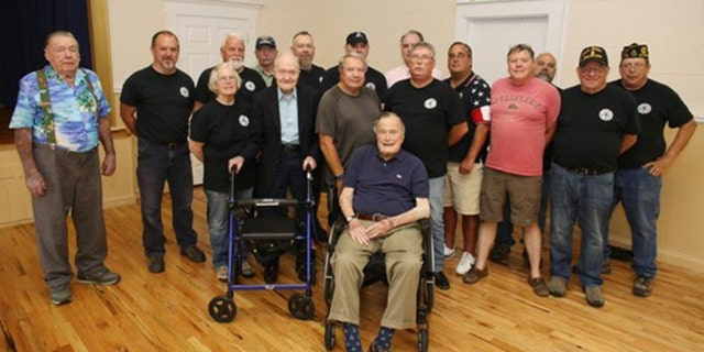 Bush seen posing with attendees of a monthly pancake breakfast at the American Legion Post 159 in Kennebunkport, Maine on Saturday. (Office of former President George H.W. Bush via AP)