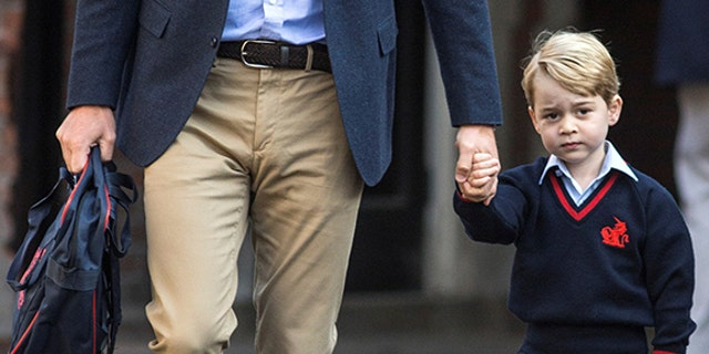Britain's Prince William accompanies his son Prince George on his first day of school at Thomas's school in Battersea, London, September 7, 2017.