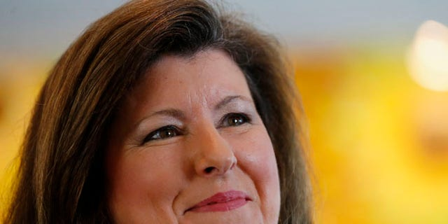 Karen Handel speaking to a reporter in Roswell, Georgia. She is one of 11 Republican candidates vying for the seat that was left open when Tom Price took a position in the Trump administration.