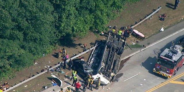 Officials respond to a crash involving a charter bus carrying a church group outside Atlanta.
