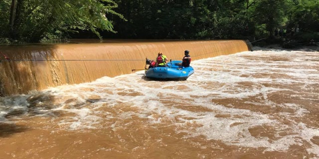 Authortiies search Barber Creek for two missing teenage boys.