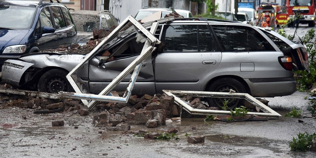 A car is destroyed after an explosion of a house in Wuppertal, Germany, June 24, 2018.