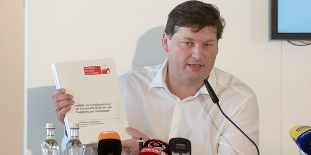 Ulrich Weber, a lawyer tasked with shedding light on the Regensburg Cathedral abuse case, speaks at a press conference at which the release of the final report on the case was announced in Regensburg, Germany, Tuesday, July 18, 2017.